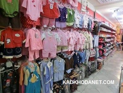 مدل دکوراسیون فروشگاه لباس بچه گانه فروشی